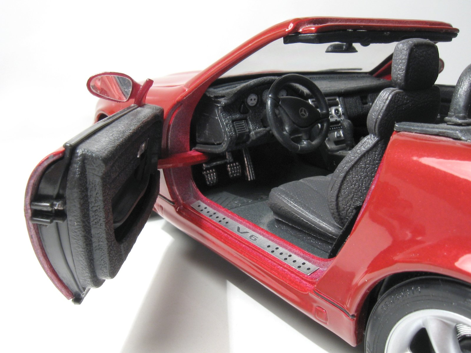 A scale model of a red car