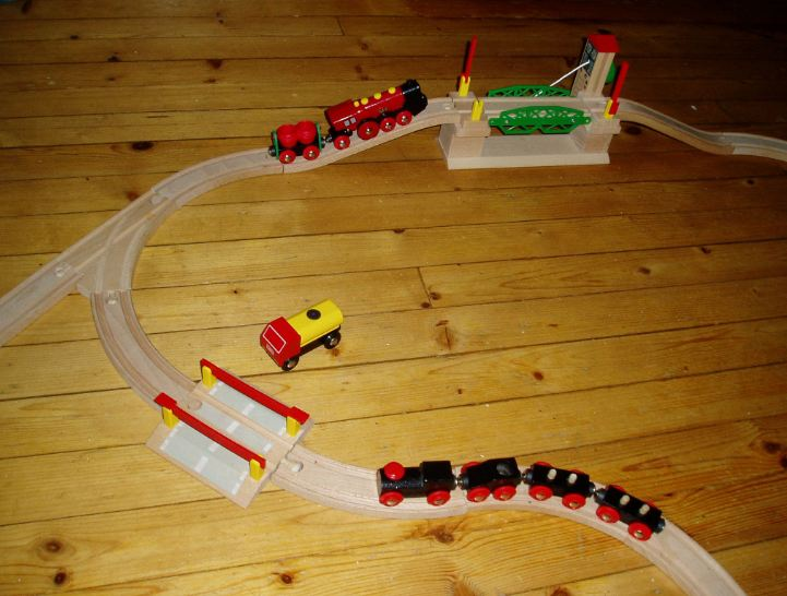 wooden track, miniature model trains, bridges and ramps