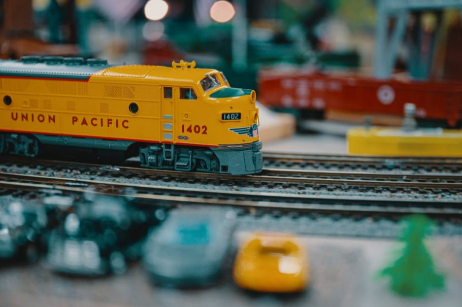A yellow model train